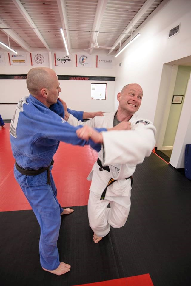 Mike Schmidt and Don Schmidt practice judo techniques at their club.