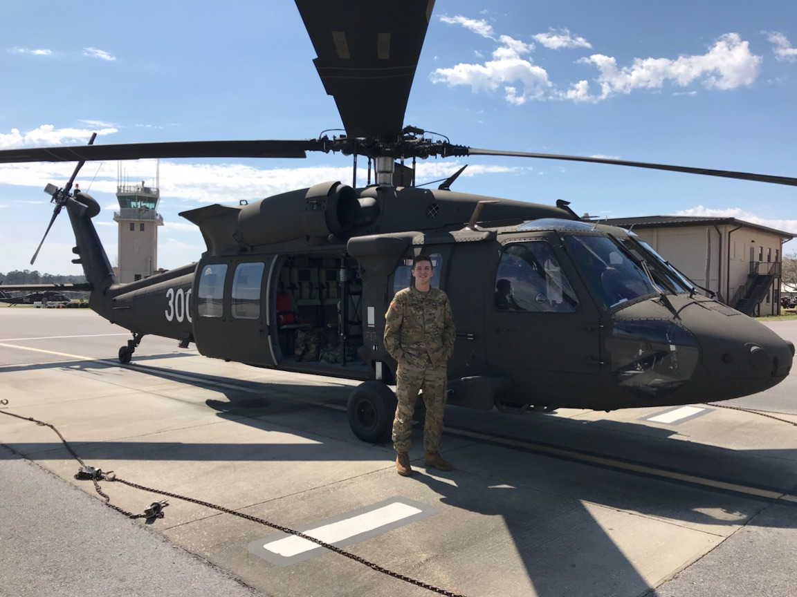 Second Lieutenant Nicholas Burchell in front of a UH-60M Blackhawk before his first flight.