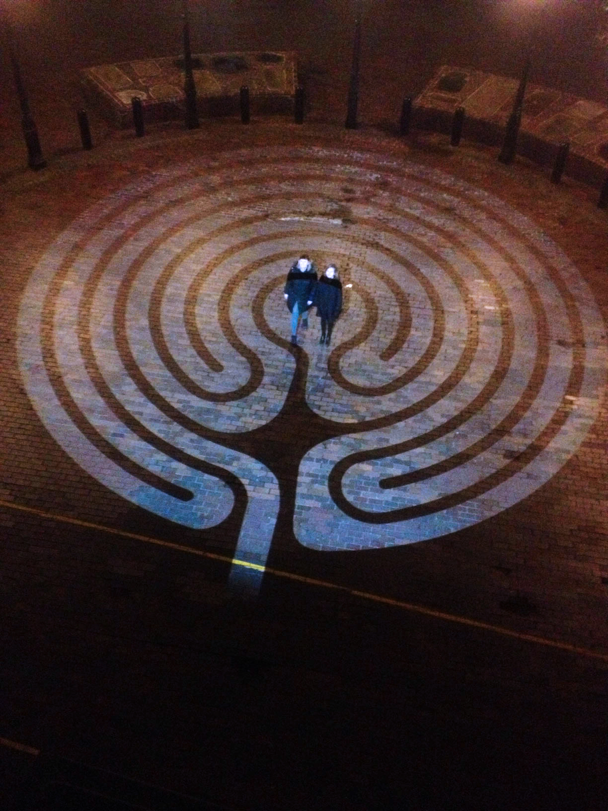 GoboPro LED projector used to make a labyrinth at night on the pavement.